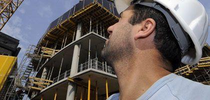 Hohe Ziele: Hochtief-Arbeiter auf Düsseldorfer Baustelle