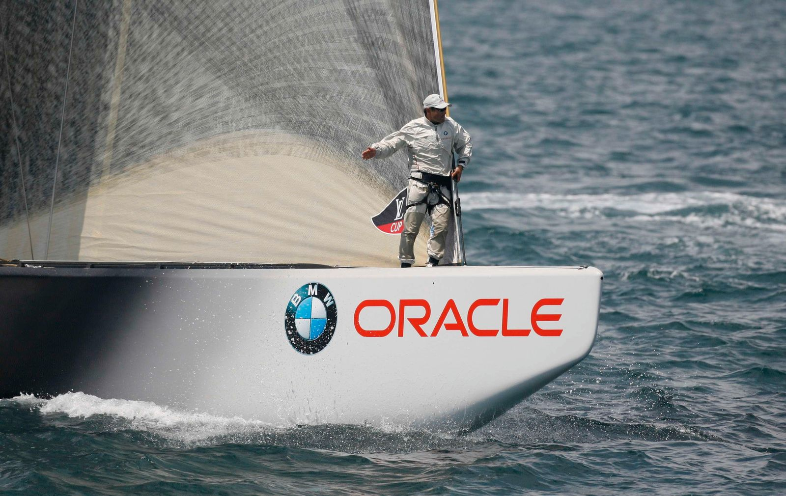 Bowman of America's Cup Challenger BMW Oracle Racing of the U.S. signals during the pre-start of their semi-final Race 4 at the Louis Vuitton Cup in Valencia