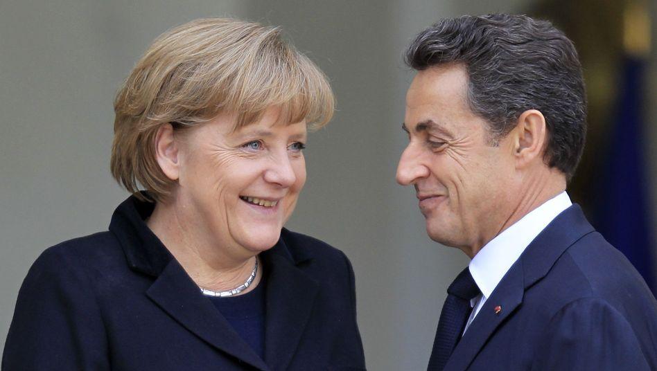 """Merkel, Sarkozy: """"Was sich bisher ereignet, darf sich nie wieder ereignen"""""""