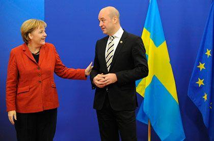 EU-Gipfel in Brüssel: Kanzlerin Merkel und Eu-Ratspräsident Frederik Reinfeldt suchen gemeinsame Positionen zur Verschuldungskrise und Klimabeschlüssen