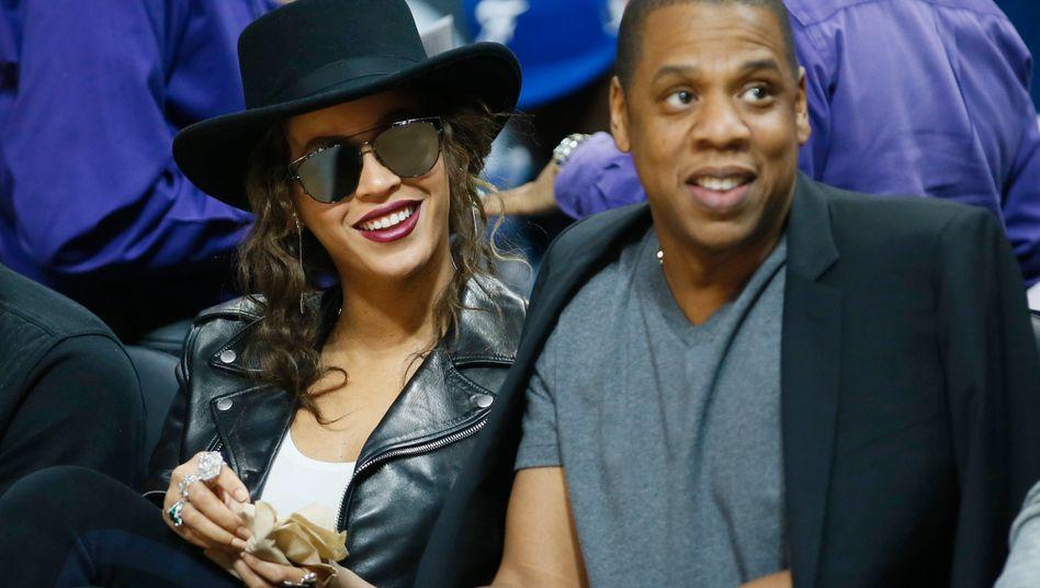 Jay Z mit Freundin Beyonce: Der Streamingdienst Tidal bietet auch Songs des kürzlich verstorbenen Prince