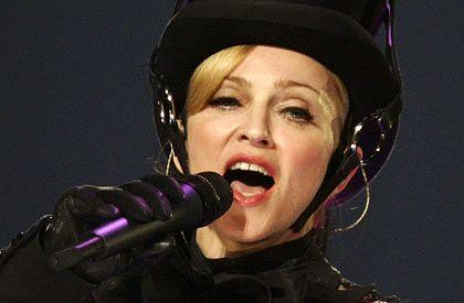 Rekordumsatz: Downloads von Musikhits (Bild: Sängerin Madonna) werden hierzulande immer beliebter