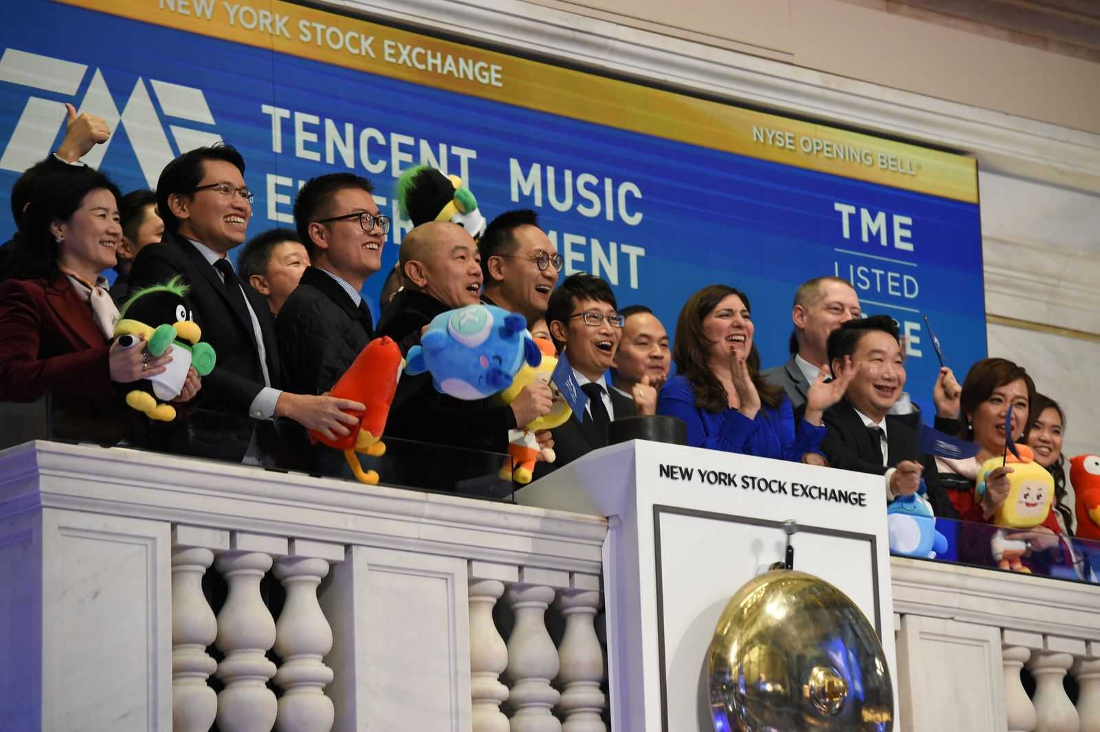 FILE PHOTO: Tencent Music Entertainment officials celebrate the company's IPO on the floor of the New York Stock Exchange