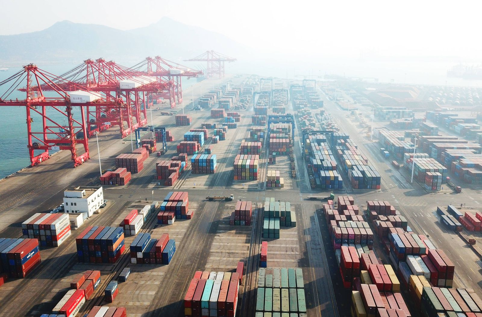 LIANYUNGANG, CHINA - JANUARY 14: Aerial vew of shipping containers sitting stacked at Lianyungang port on January 14, 2