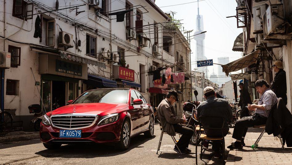 Daimler wird wohl weniger Autos in China verkaufen, erwartet der Konzern