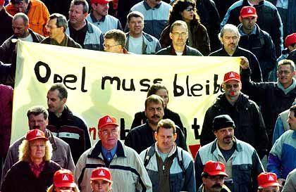 Müde Gesichter: Nach sechs Tagen Ausstand sieht Opel für morgen eine Chance, dass die Arbeiter an die Werkbänke zurückkehren