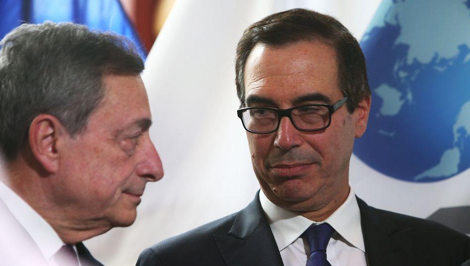 US-Finanzminister Steven Mnuchin (rechts) im Gespräch mit Marion Draghi, Präsident der Europäischen Zentralbank