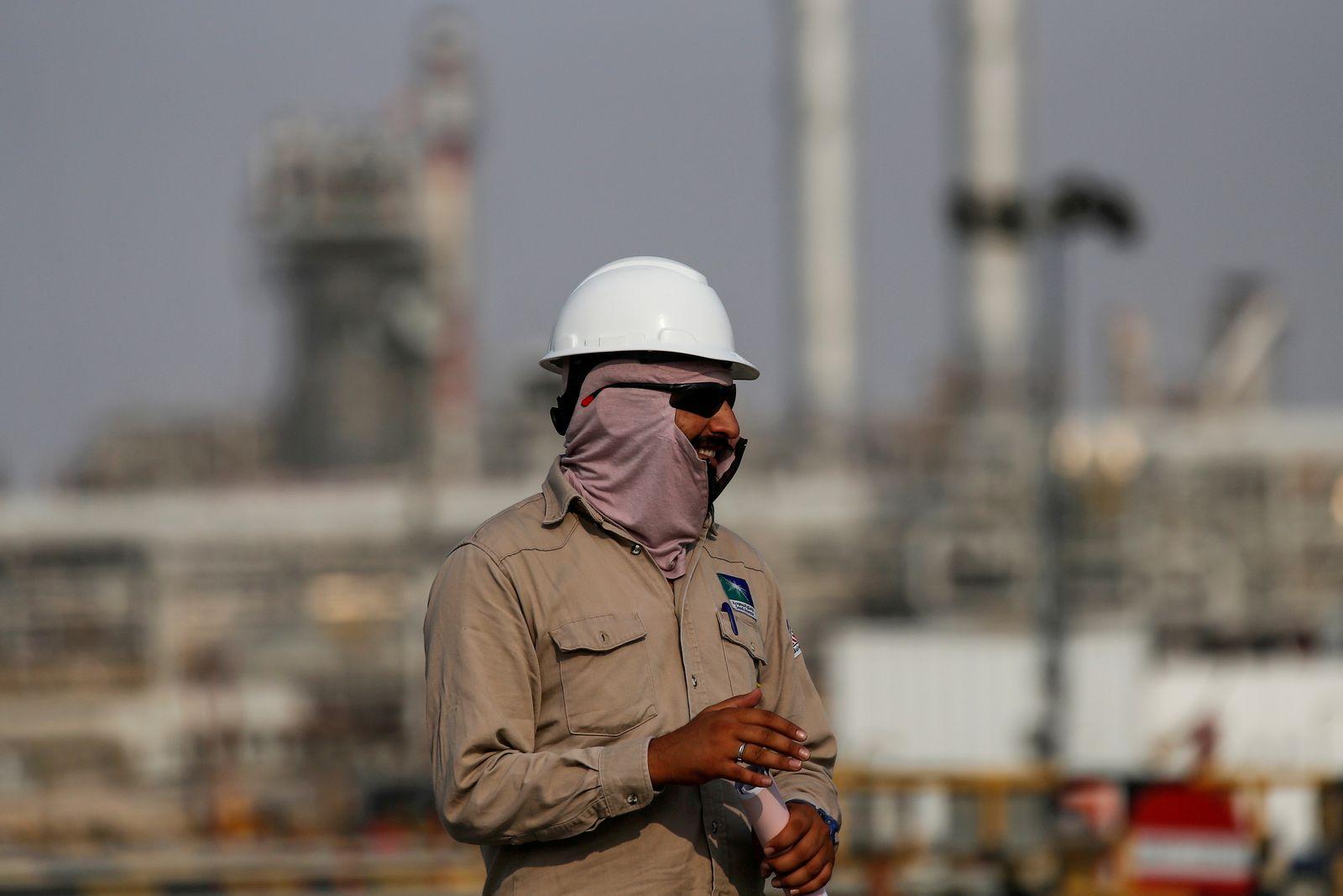 FILE PHOTO: An employee looks on at Saudi Aramco oil facility in Abqaiq