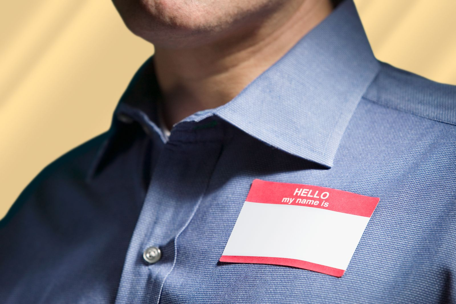 """Man Wearing """"Hello My Name Is"""" Tag"""