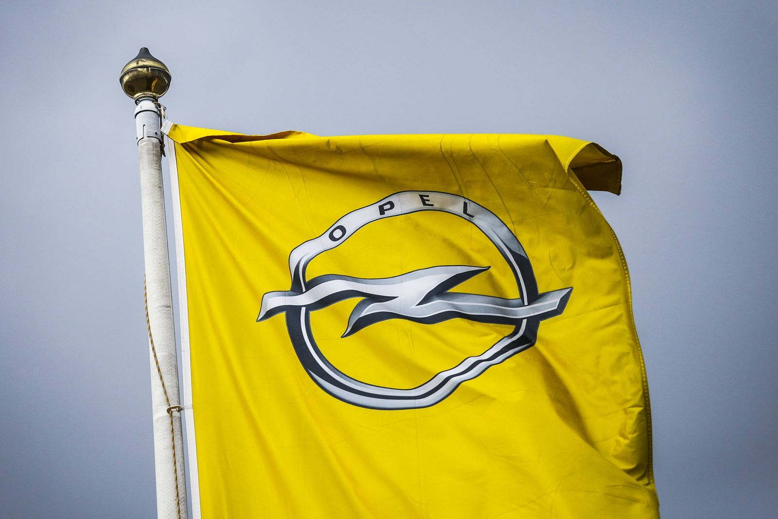 March 7, 2017 - Gliwice, Poland - A flag with the logo of Opel company outside the Opel car factory of General Motors M