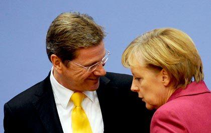 "Koalitionäre Westerwelle, Merkel: ""Entschlossenheit ist jetzt gefragt"""