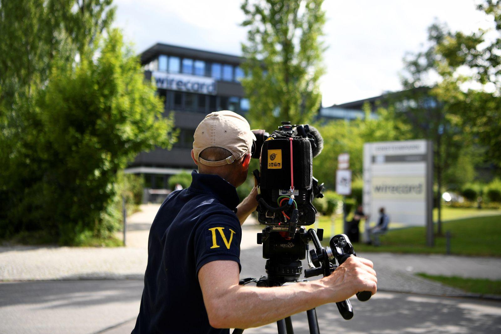 A cameraman films the headquarters of Wirecard AG in Aschheim