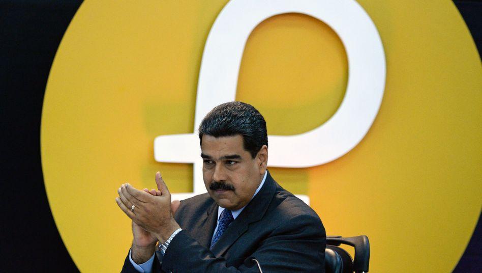 Venezuelas Präsident Nicolas Maduro verkündet stolz den Staat einer eigenen Kryptowährung