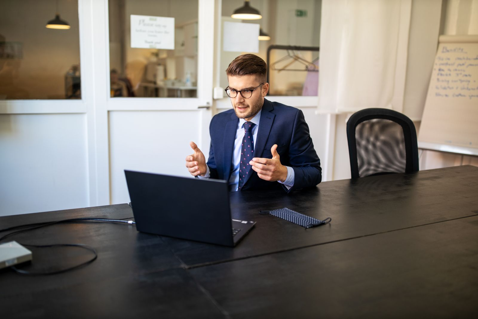 Businessman having a conversation with client over a virtual meeting