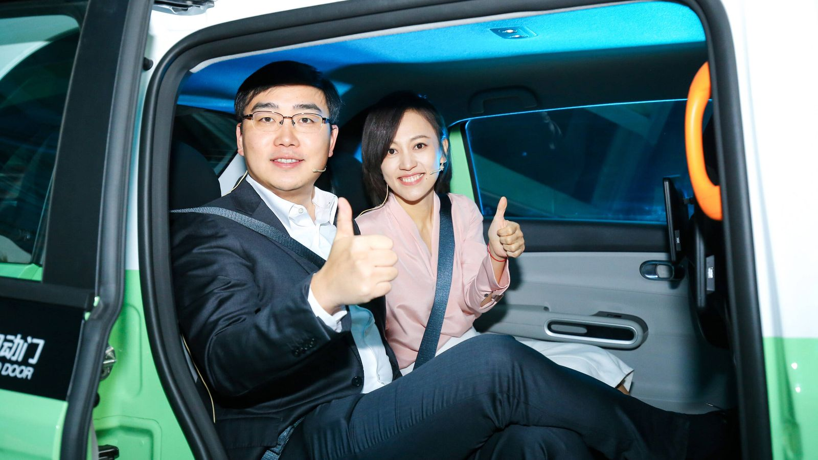 BEIJING, CHINA - NOVEMBER 16: President of Didi Liu Qing (R) and CEO of Didi Cheng Wei sit in a D1 electric vehicle duri