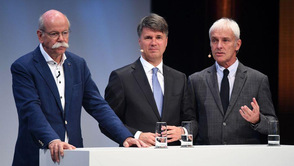 Dieter Zetsche (Daimler), Harald Krüger (BMW) und Matthias Müller (Volkswagen): Deutsche Autobauer unter Kartellverdacht