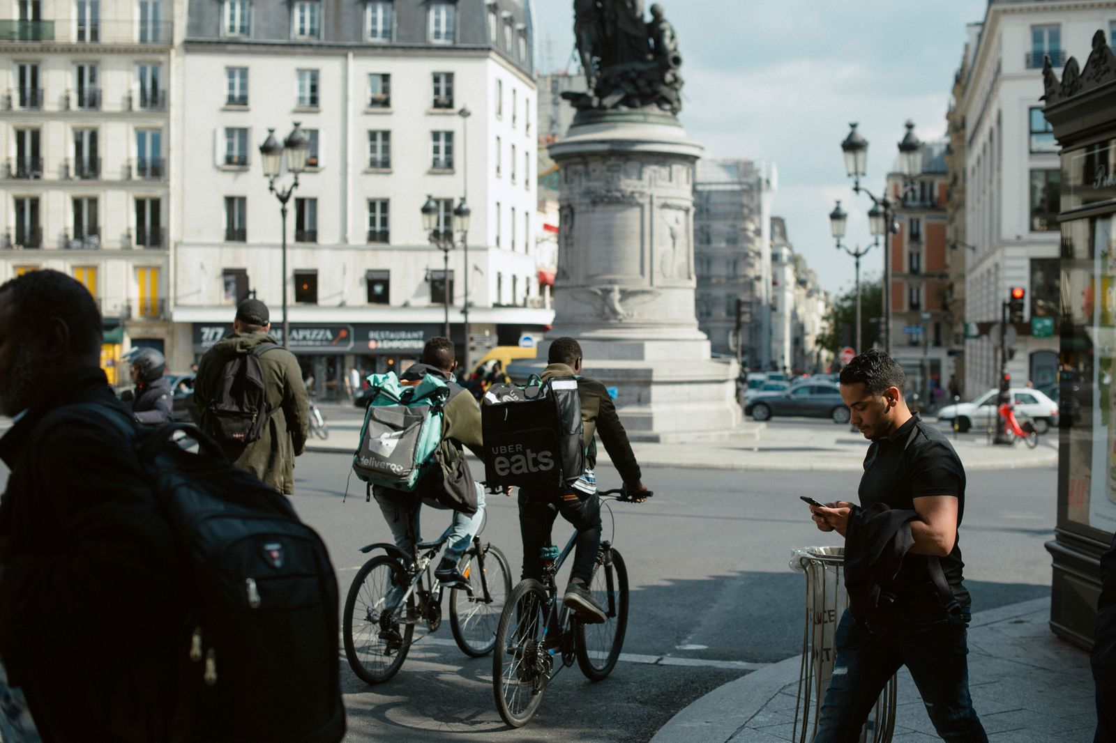 Deliveroo and Uber Eats couriers in Paris