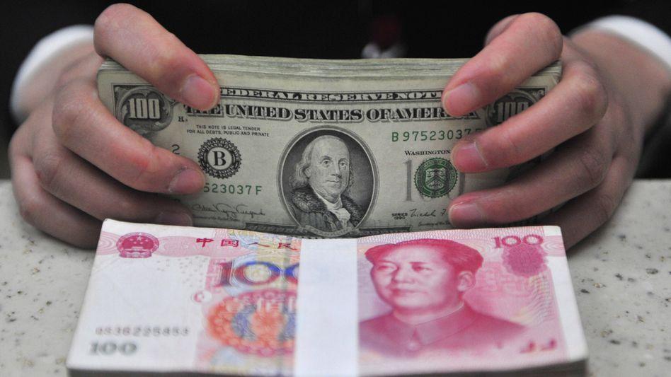 Dollar gegen Yuan: Die Verschuldung der USA sind genauso ein Problem wie die extremen Handelsbilanzüberschüsse Chinas
