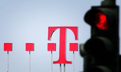 Konzern sucht Ausweg: Die Deutsche Telekom drücken Schulden, doch sie muss investieren, um das Auslandsgeschäft zu forcieren