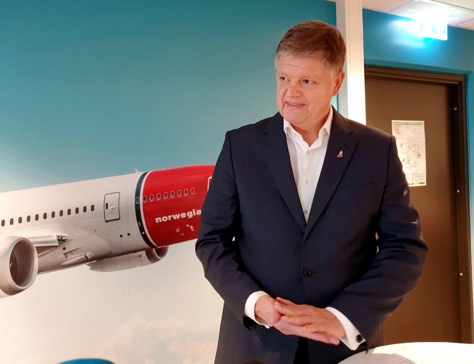 FILE PHOTO: Norwegian Air CEO Schram speaks to media in Oslo