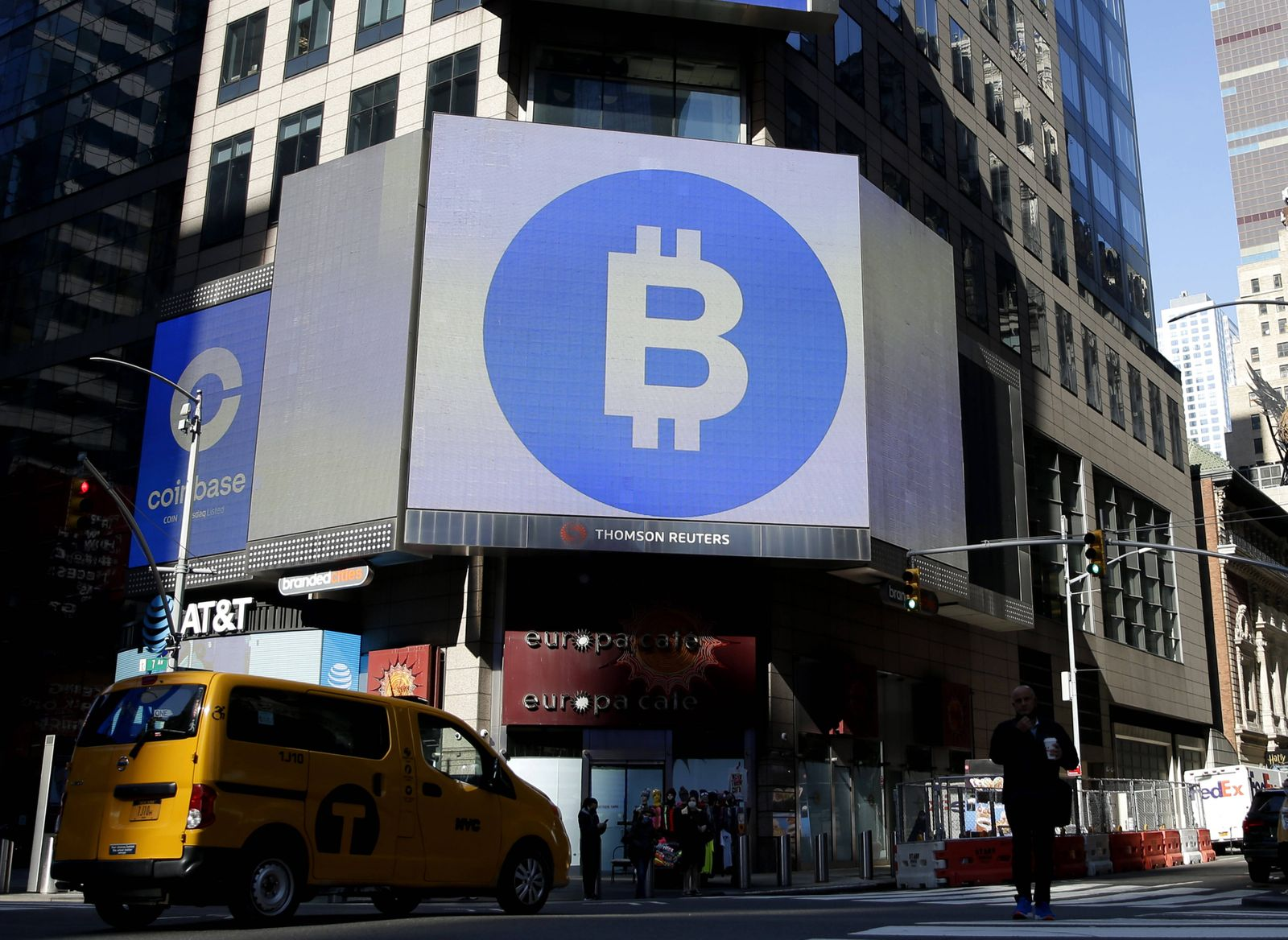 The Bitcoin logo is displayed on a screen in Times Square when Coinbase Global, Inc. beings trading under the symbol CO