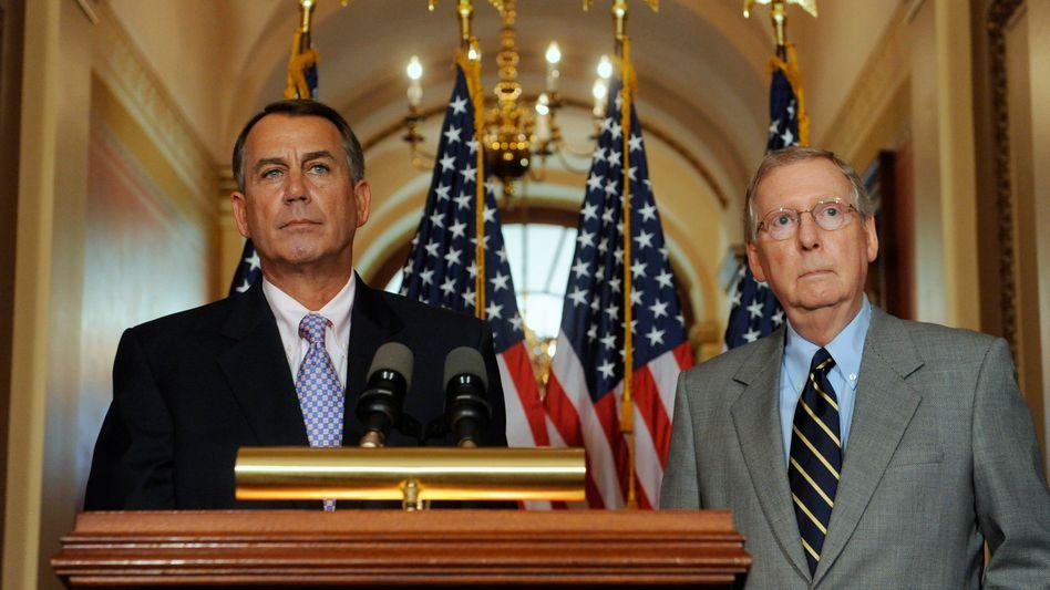 Erfolg der Opposition: John Boehner (links) and der Führer der Republikaner im Senat, Mitch McConnell, haben sich erfolgreich gegen Steuererhöhungen gewehrt