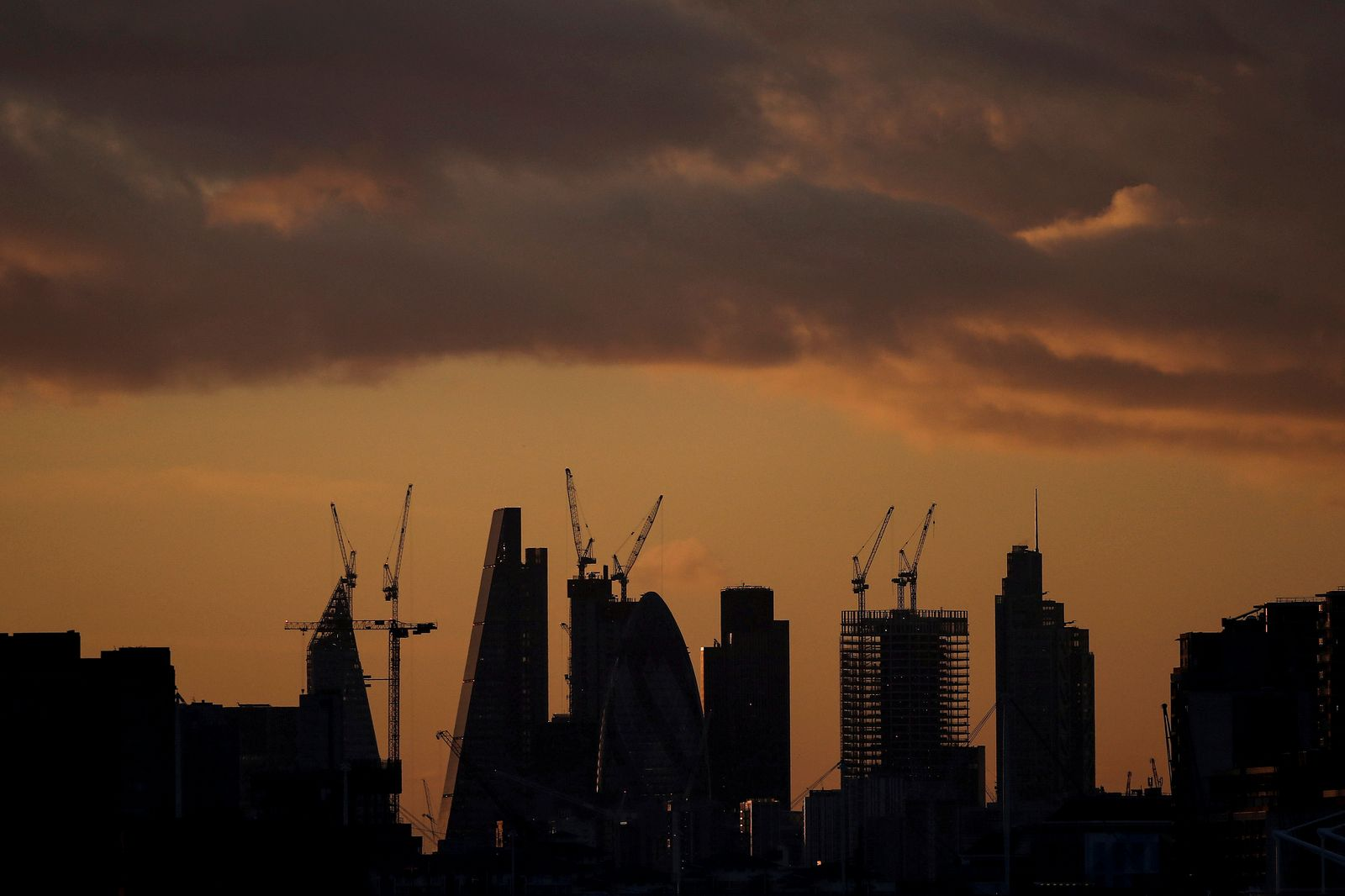 FILE PHOTO: FILE PHOTO: Skyscrapers stand at sunset in the city of London's financial district in London