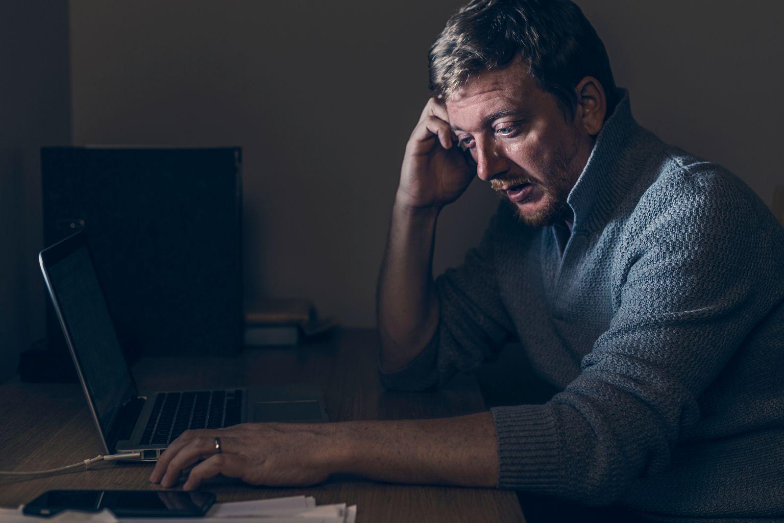 Sad Man at Home Desk