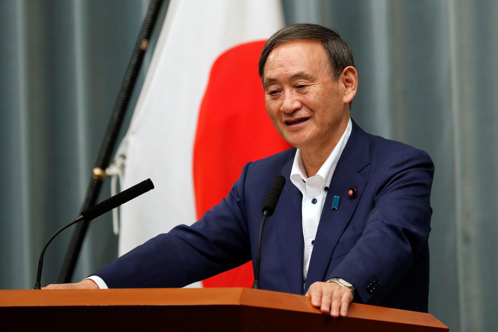Japan's Chief Cabinet Secretary Suga holds a regular news conference in Tokyo