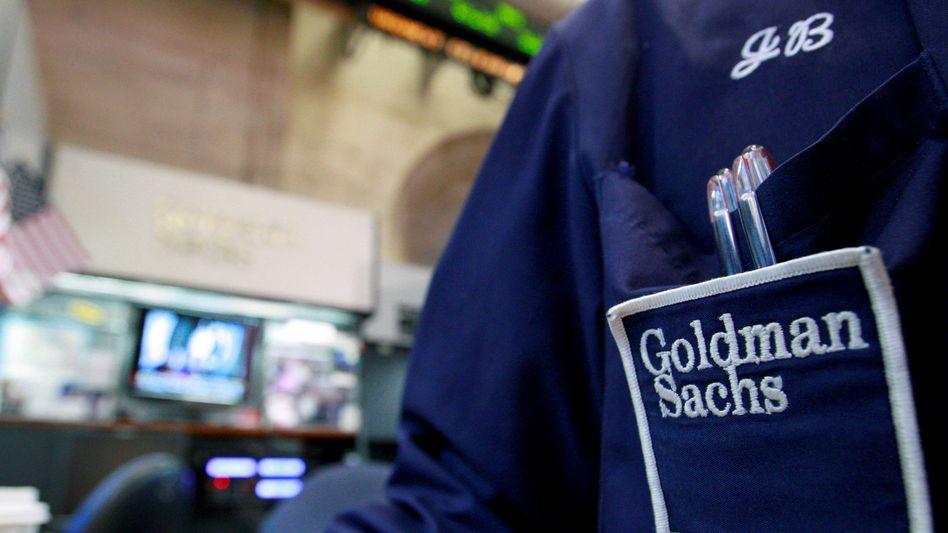 Goldman-Sachs-Händler an der Wall Street: Viele große Finanzhäuser beteiligen sich nach wie vor an Unternehmen, die viel zum Klimawandel beitragen.