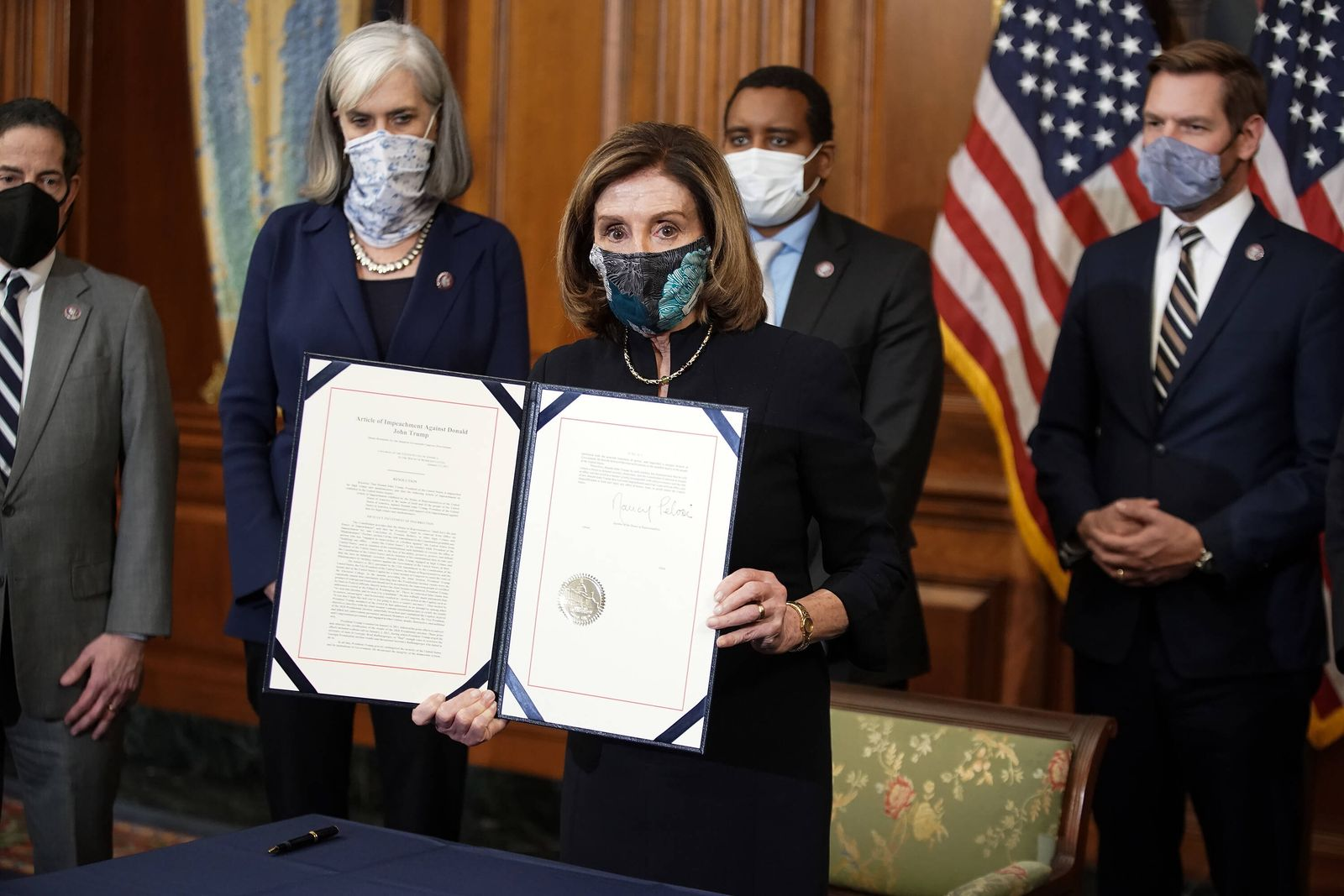 January 13, 2021, Washington, District of Columbia, USA: Speaker Nancy Pelosi (D-Calif.) holds H.R. 24, an article of i