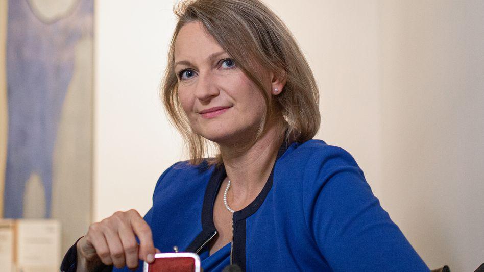 Börsenfang: Die Unternehmerin Katharina Schüller mit ihrer Red Purse