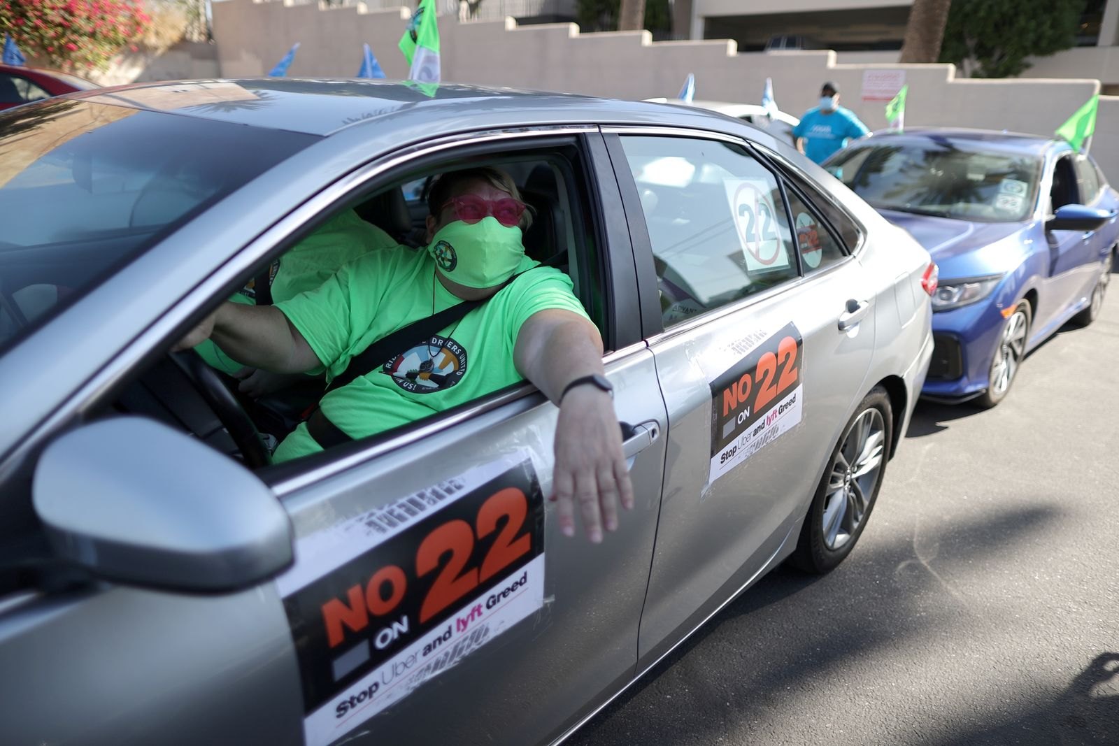 FILE PHOTO: Tammie Jean Lane, 61, joins a protest by Uber and Lyft rideshare drivers against California Proposition 22 in Los Angeles