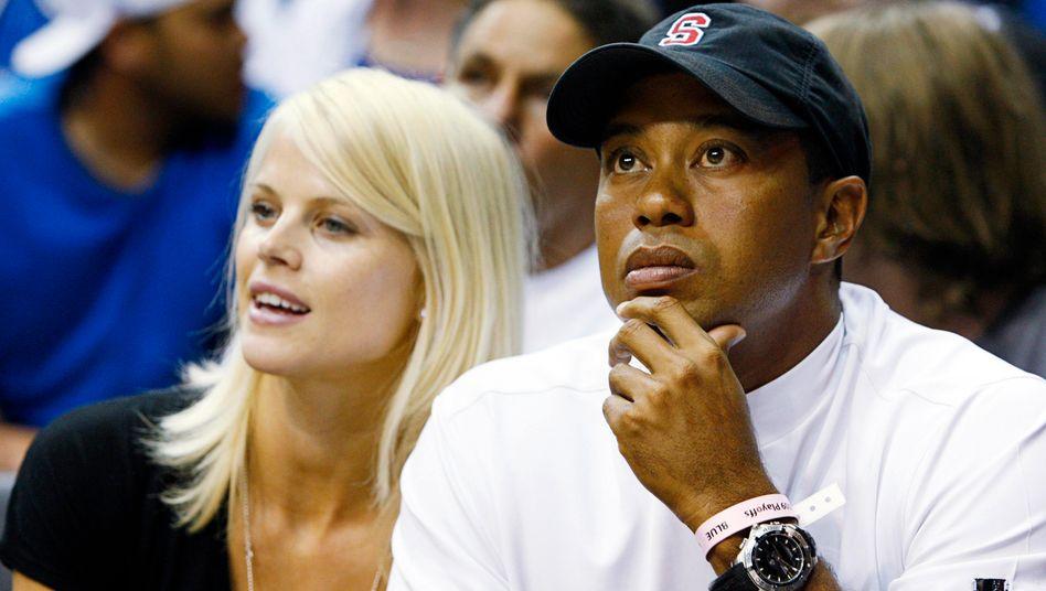 Ein Bild aus besseren Zeiten: Golf-Star Tiger Woods und Ehefrau Elin Nordegren. Nach der Scheidung kassierte das Model 100 Millionen Dollar