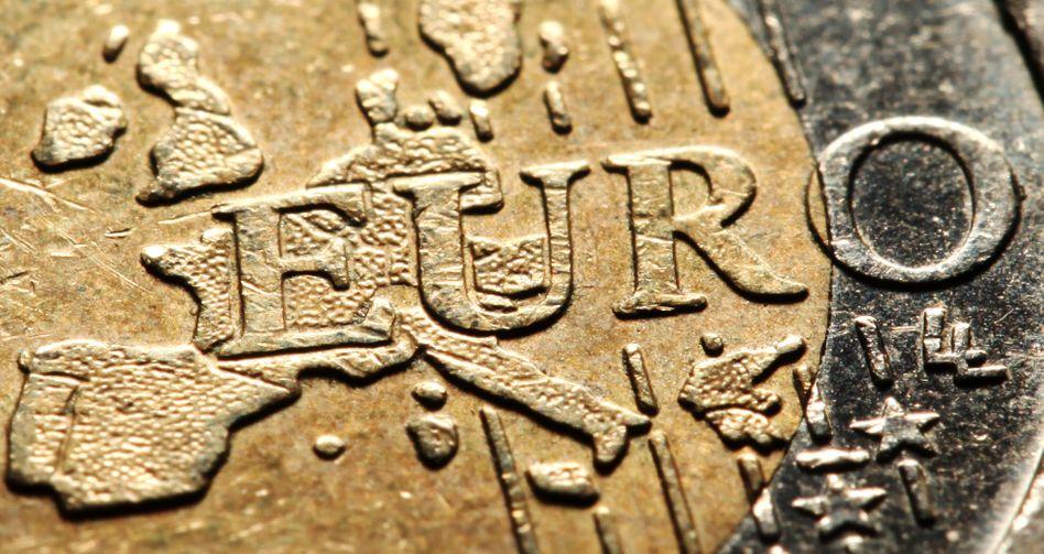 Gefährdete Währung: Die Schuldenkrise in Europa belastet den Euro