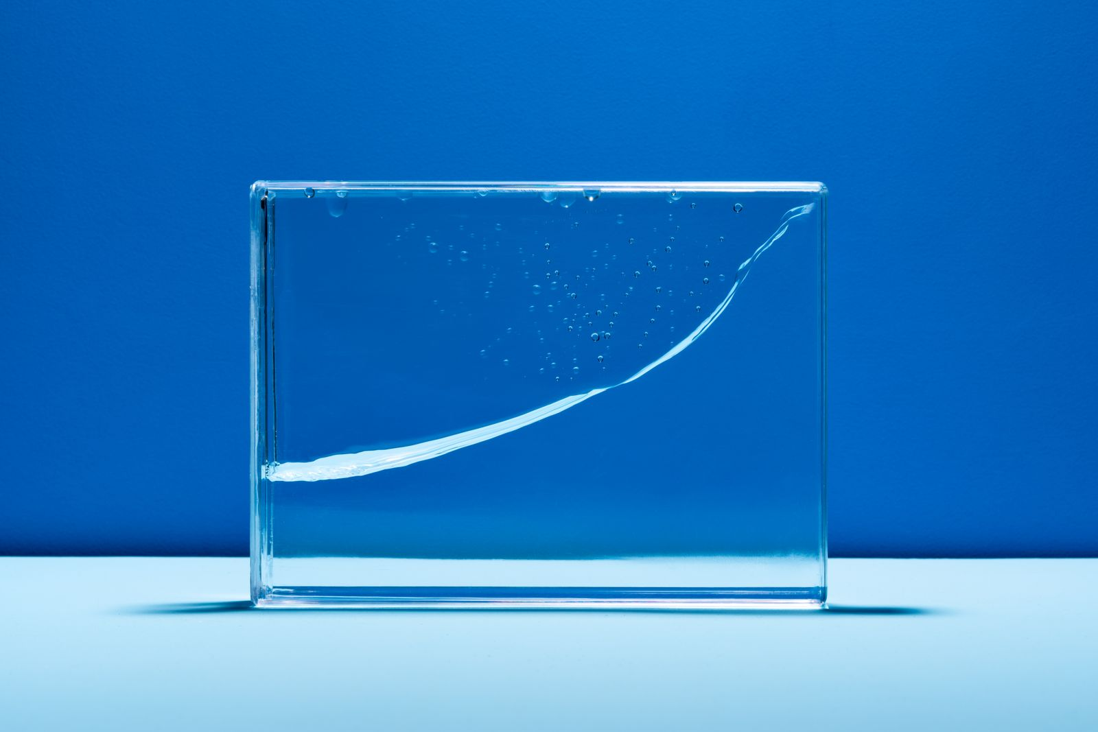 Water Wave in Glass Box Abstract Line Graph