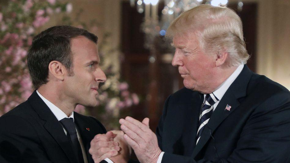 Macron (l.) und Trump in Washington