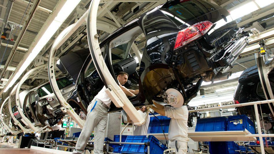 Künftig mehr Maschine statt Mensch: Volkswagen-Produktion in Wolfsburg