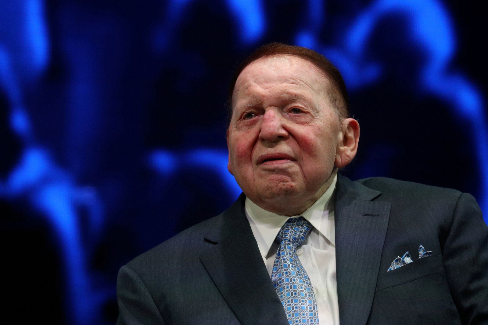FILE PHOTO: FILE PHOTO: Sheldon Adelson sits onstage before a speech by U.S. President Trump at the Israeli American Council National Summit in Hollywood, Florida