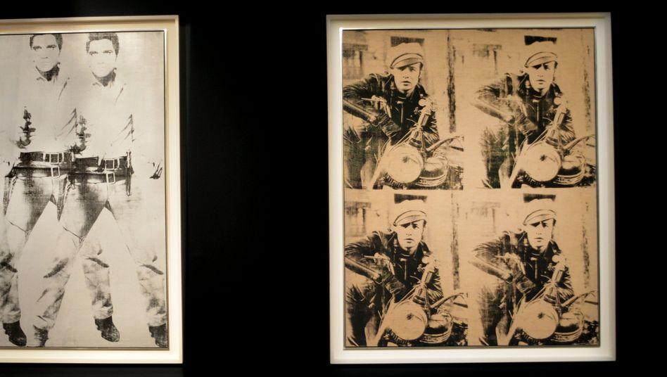 «Triple Elvis» und «Four Marlons» von Andy Warhol: Die beiden Bilder wurden Ende 2014 für 151 Millionen Dollar versteigert. Zwischen 2010 und 2014 lief der Kunstmarkt heiß - doch nun gehen Preise und Umsätze zurück