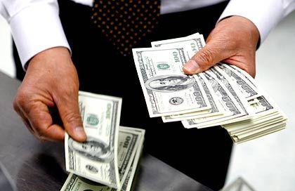 """Dollar-Scheine: """"Finanzminister Tim Geithner wird bald eine neue Strategie vorstellen, um unser Finanzsystem zu beleben"""""""