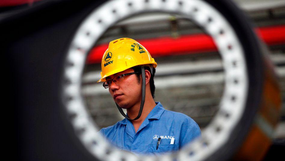 """Produktion beim chinesischen Konzern Sany: Die Wirtschaft soll künftig nicht nur eine """"Basis""""-Rolle, sondern eine """"entscheidende"""" Rolle spielen. Für die nötigen Wirtschaftsreformen soll ein neu geschaffenes Führungsteam sorgen"""