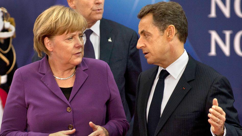 """Merkel und Sarkozy in Cannes: """"Die Ankündigung des griechischen Referendums habe die """"psychologische Situation massiv verändert"""""""