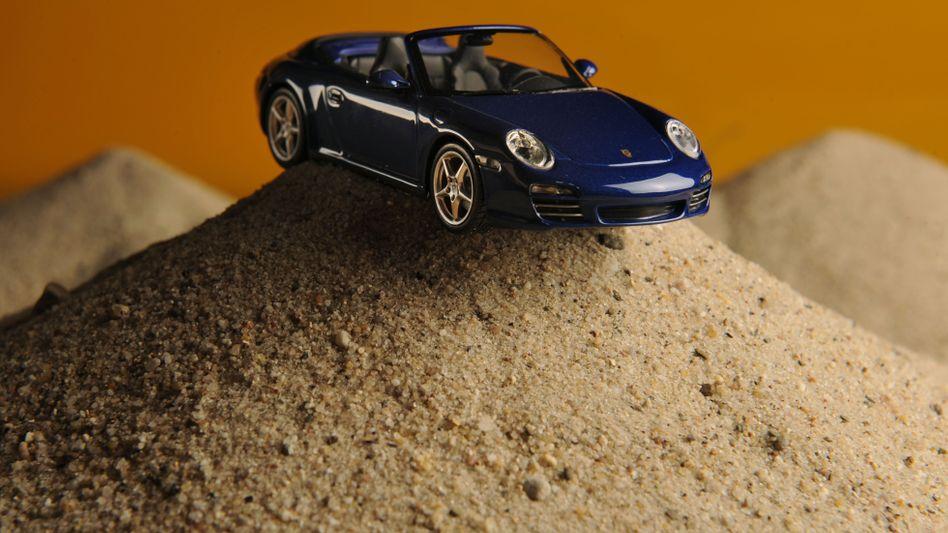 Katar schickt Porsche nur sprichwörtlich in die Wüste: Beim Mutterkonzern VW bleibt das Emirat engagiert