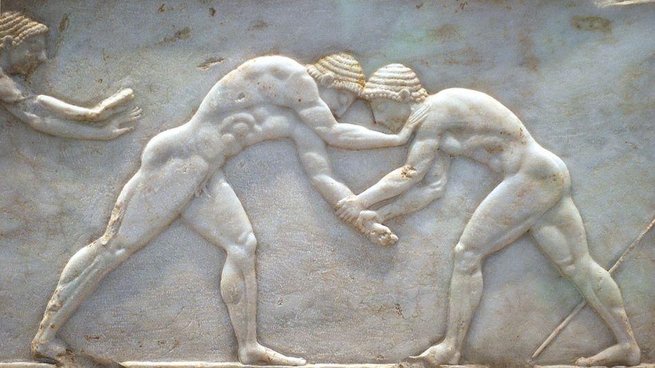 Griechische Ringkämpfer: Das Land ringt mit weiter steigenden Schulden. Ohne weitere Finanzspritzen der Euro-Länder und des IWF droht der Staatsbankrott