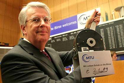 Udo Stark gibt Gas: Der Vorstandschef der MTU Aero hält mit einem Schubhebel an der Frankfurter Börse