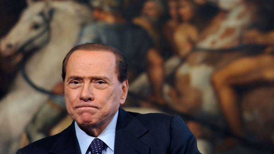 Unter Druck: Italiens Ministerpräsident Silvio Berlusconi steht wegen der desolaten Finanzlage des Landes heftig in der Kritik