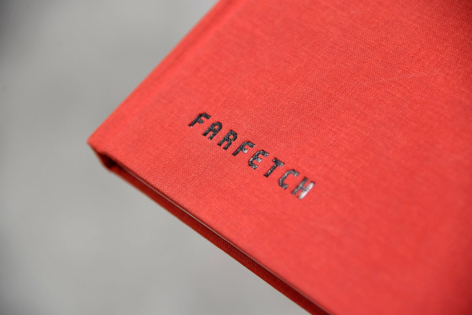 FILE PHOTO: Branding for online fashion house Farfetch is seen at the company headquarters in London