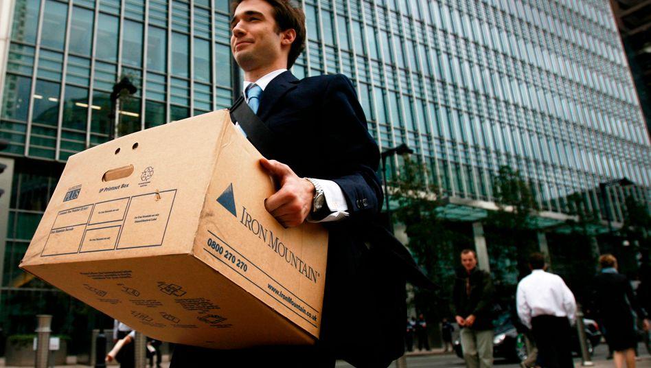 Symbol der Finanzkrise: Ein Mitarbeiter der insolventen Investmentbank Lehman Brothers verlässt im September 2008 seinen Arbeitsplatz - sechs Jahre später ist die Wall Street wieder wohlauf