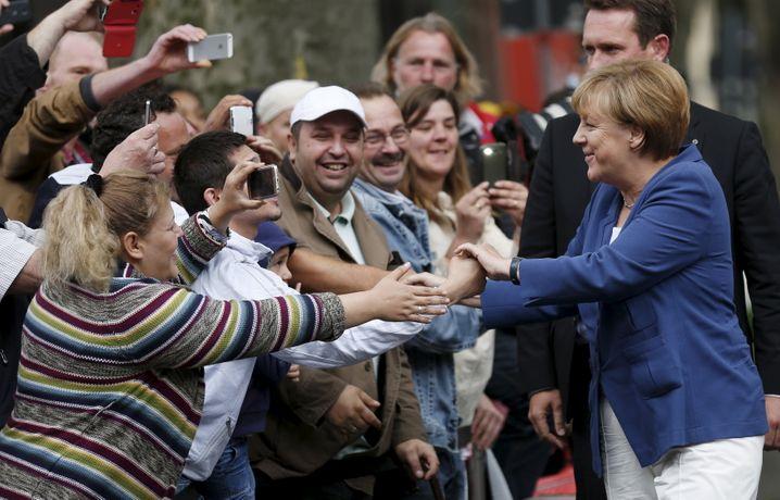Angela Merkel beim handshake
